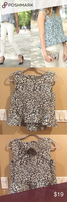 Zara Leopard Print Peplum Top Basically NWOT. Super cute leopard print peplum top. Somewhat loose, short fit. Cutout and buttons in back. Size small. Worn once and washed. I do not own first photos, just borrowing because I suck at modeling. Zara Tops Blouses