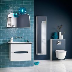 Dark blue bathroom furniture and tiles from Utopia Bathrooms. Bathroom Trends, Budget Bathroom, Bathroom Storage, Small Bathroom, Towel Storage, Bathroom Closet, Turquoise Bathroom, Bathroom Colors, Bathroom Showrooms