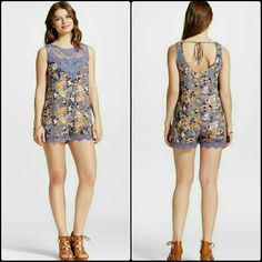 Adorable Floral Romper 100% rayon fabric is super lightweight ? Back cutout shows a peek-a-boo of skin ? Lace accents add major sweetness ? Length hits around mid-thigh ? Model wears size XS and is 5?9.5??  Trendy and adorable, this Women's Floral Romper Chambray by Xhilaration (Juniors') gives you a flirty outfit in a snap. Add strappy sandals and a leather hobo bag and you?re ready for wherever your summer takes you.  Sizing:?JuniorDecorative Details:?Lace trimMaterial:?100…