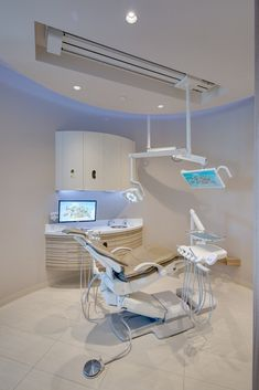 Neutral colored dental office design with the A-dec 500 dental chair creates a calming operatory.