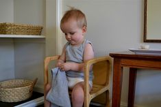 (Self Care Area) montessori at home blog - lots of great information    Get some table, repurpose, put mirror above it with brush, comb, and some cloth wipes. Easy!