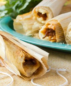 There really is nothing quite like a multi-day cooking project to ease winter's biting chill, and with the current temperatures in the single digits I'm sure we could all use an activity to bide our time indoors. These Southern-style tamales are the perfect way to get your friends and family off the couch and into the kitchen, and a batch is guaranteed to keep your minds occupied and bellies warm!