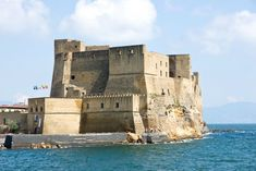 """Castel dell'Ovo in Naples  The name of this castle, """"Egg Castle,"""" comes from a legend that Virgil put a magical egg into the castle's foundations to support it. That's not too likely, but what we do know is that the castle you see here was built by the Normans back in the 12th century, and later served as theseat of the Royal Chamber and of the State Treasury of Naples."""