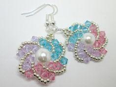 He encontrado este interesante anuncio de Etsy en https://www.etsy.com/es/listing/218093112/pastel-swirl-swarovski-elements-earrings
