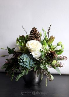 Winter Flower Arrangement with Succulents Roses and Pine Cones