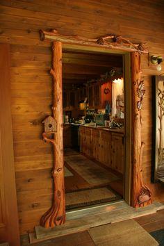 Beautifully rustic carved door frame for a cabin. Casa Dos Hobbits, Cabin Doors, Log Home Interiors, The Doors, Entry Doors, Log Cabin Homes, Log Cabins, Rustic Cabins, Door Trims