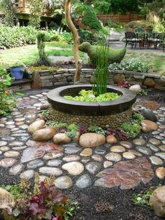 garden focal point / fire pit with a cobblestone path by tina66