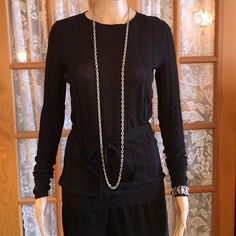 """Simply Vera Vera Wang Black Long Top No fabric tag but it feels like a super soft acrylic. Bust is 32"""" with lots of stretch. Length is 27 1/2"""". The tie belt is 10"""" up from the hem. Sleeves are 25"""" with a 4"""" cuff. No holes, rips, stains or tears. Non smoking home. Vera Wang Tops"""