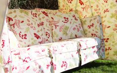 Idler swing seat with green exterior and floral interior