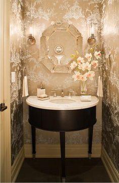 Gorgeous feminine power room. Love the metallic chinoiserie toile wallpaper & delicate vanity