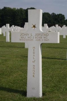 Major John L. Jerstad U.S. Army Air Forces Service # O-435784 Headquarters, 2nd Bomber Wing  Entered the Service from: Wisconsin Died: August 1, 1943 Buried: Plot C, Row 24, Grave 10 Ardennes American Cemetery Neupré, Belgium Medal of Honor