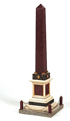 An italian neoclassical style porphyry Obelisk ; beautifull base with a mix of white carrara marble & dark granite ; also with fine light ormolu bronze details. Rome 19th/20th Century - In the manner of Fr. Righetti - Righetti (1749-1819) pupil of Luigi Valadier, did many reductions of antique bronze sculptures selling those to contemporary travelers passing through Rome. His catalog of 1794, written in French mentioned clocks, vases, urns, obelisks, etc... objects in the antique taste.