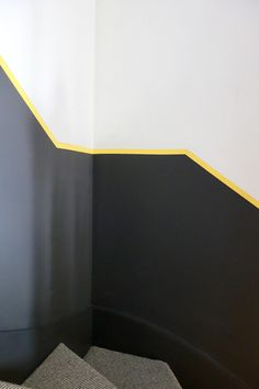 I have been asked about how to do a half-painted wall so many times, and as it's a technique that is perfect for modern homes and those with low ceilings, I Stairwell Wall, Hallway Paint, Stair Walls, Hallway Walls, Dark Hallway, Stairs, Black Painted Walls, Wall Paint Patterns, Hallway Colours