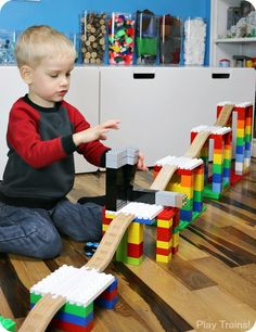 Creative Building Play with DUPLO and Wooden Train Tracks - When Dreamup Toys sent us these building toys that connect wooden train tracks to interlocking buil - Lego Activities, Toddler Activities, Lego For Kids, Diy For Kids, Construction Lego, Lego Challenge, Wooden Train, Toddler Play, Lego Building