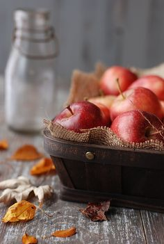 Simple way to present apples, cut piece of hessian in wood tray or bowl -- good idea for pirate party maybe.