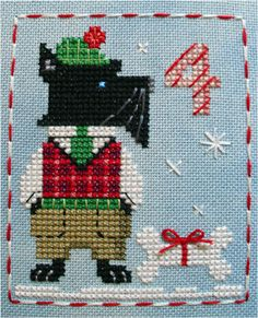 It's Duncan Dog! #4 in the Brooke's Books Advent Animals Cross Stitch Freebies Collection by Brooke Nolan: http://prosites-brookeanolan.homestead.com/CrossStitchFreebies2.html