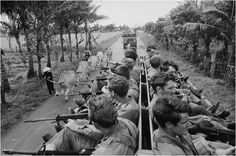 Vung Tau, South Vietnam: Part of a newly-arrived battalion of Australian troops rides back-to-back with guns at the ready in case of ambush immediately after coming ashore and boarding a truck convoy, November 28, to their base camp at Nui Dat. The 8th Australian Battalion is replacing the 9th Australian Battalion. November 28, 1969.