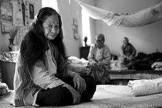 Elderly women sitting on their beds at the Buddhist Home for Aged People, Mingun, Mandalay, Myanmar (Burma)