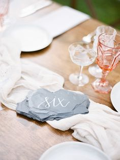 Painted calligraphy rock table numbers: http://www.stylemepretty.com/2016/03/24/dreaming-of-a-fairytale-wedding-in-the-redwoods-look-no-further/ | Photography: Coco Tran - http://www.cocotran.com/