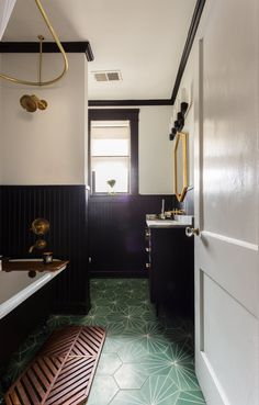 Kat and Brett totally re-did the bathroom and designed the details themselves. The flooring is Claesson Koivisto Rune Dandelion in pea green/pure white. Sink cabinet: Old City Millwork, Memphis. Bath mat: Anthropologie (no longer available).