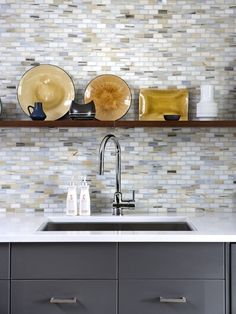 Update your faucet for a new look.  The faucet draws a lot of attention and is the most used fixture in the kitchen, so even this single change can make a big difference. Chrome gives a sleek look, or try something trendy like a matte black to add some edge.