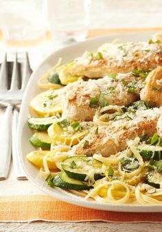 Farmers' Market Chicken Skillet — Make the most of your farmers' market finds with this chicken and pasta skillet recipe topped with zucchini, squash, garlic, cheese and fresh basil. (Skillet Squash Recipes)