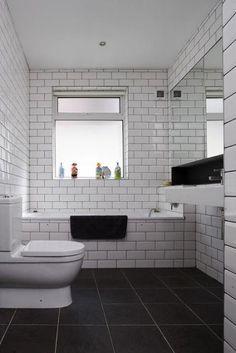 Dark grey floor and white subway tile.