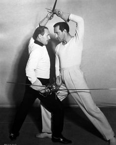 Basil Rathbone with fencing instructor Fred Cavens