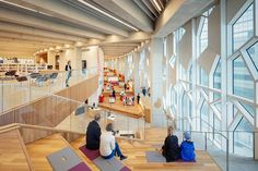 snøhetta and dialog's new central library in calgary incorporates a rail line