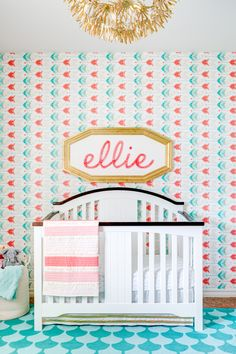 Modern Coral and Aqua Nursery with an Arrow Wallpaper Accent Wall - Project Nursery