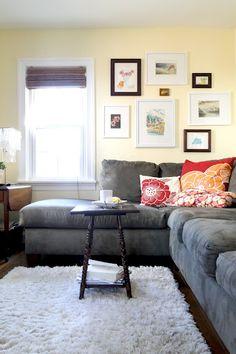 grey sofa, dark floors, light rug