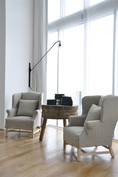 Briggs Edward Solomon Wingback chairs - slipcovers - bare wood floors