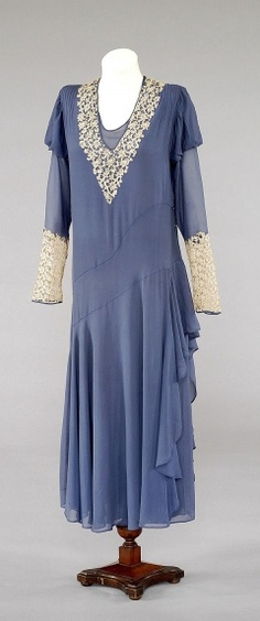 1932 Wedding Dress, deep power blue, silk crêpe, trimmed at neck and cuffs with cream guipure lace and self-fabric bias flounce on left side.