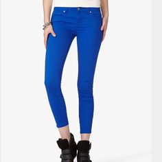 Blue Zippered Skinny Jeans Worn but good condition. Size 24. Zippers at the ankles. Forever 21 Jeans Skinny