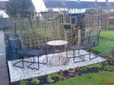 Mosaic tiled patio, using ordinary floor tiles cut by manual tile cutter, used a electric tile cutter to shape the middle round one. Done on a slab of concrete.