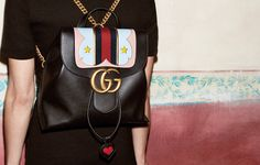 Bright Spot: Inset with leather hearts and stars, Gucci's Marmont chain strapped shoulder bag and backpack for fall are injected with color and whimsy.
