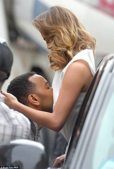 He loves all of her! John Legend nuzzles wife Chrissy Teigen during a photo shoot in NYC o...