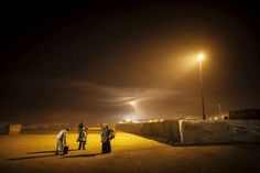 Syrian refugees shelter against the cold at Za'atari refugee camp, Jordan.  Between midnight and 4 A.M., 369 refugees fleeing from conflict in neighboring Syria made their way to the camp, which is now home to 31,000 Syrian refugees. <br>© UNHCR/B.Sokol