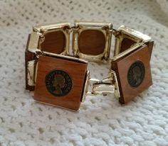 Wood Bracelet Elizabeth II Regina embossed coin emblems, vintage 1950s queen costume jewelry by AnotherTimeAntiques on Etsy