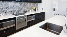 This kitchen has the 'wow' factor! The crisp black and white kitchen with Corian countertops and high gloss acrylic cabinetry Corian Countertops, Two Tone Kitchen, Kitchen Gallery, Wow Products, Double Vanity, Kitchen Cabinets, Kitchen Ideas, Home Decor, Two Toned Kitchen