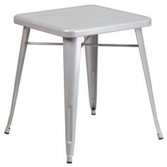 23.75'' Square Silver Metal Indoor-Outdoor Table. Create a chic dining space with this industrial style table. The colorful table will add a retro-modern look to your home or eatery. This highly versatile Cafe Table is ideal for use in bistros, taverns, bars and restaurants. You can mix and match this style table with any metal chair, even using different colors. The top features an engraved designer print. A cross brace underneath the top adds extra stability. The legs have protective…