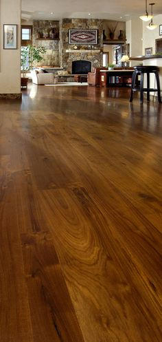 Walnut flooring is an attractive addition to any home, office or property. Walnut shows fantastic character compared to most others. Walnut wood flooring is esteemed by woodworkers for centuries. The rich dark brown color, swirling grain patterns. Dining Room Floor, Walnut Dining Room, Walnut Wood, Wood Planks, Walnut Hardwood Flooring, Hardwood Floors, Flooring, Wood Floors Wide Plank, House Flooring