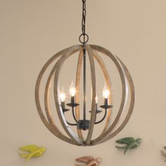 Less formal than the others I pinned but a good look over kitchen table if you want to warm it up some and not let things get too contemporary. Stanton Chandelier