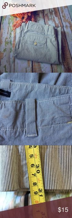 Gap Pinstriped Flared Trousers Add some pizazz to your work day with these adorable flare khakis! Featuring a railroad type pinstripe and wide flare leg. Size of flare as well as inseam both pictured. Have two tiny stains on waistband (pictured) that shouldn't be noticeable while worn at all. Otherwise in good condition. GAP Pants Boot Cut & Flare