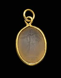 A ROMAN CHALCEDONY MAGIC GEM   Circa 3rd Century A.D.   One side engraved with a pantheistic deity with four wings, a bird tail, and a frontal bearded human face, wearing an Egyptian atef-crown and holding Egyptian was-scepters, standing on the snake Ouroboros coiled into a circle that frames the letters IAW, the other side with the lion-headed snake Chnoubis on a plinth, framed by a lengthy inscription; mounted as a pendant in a modern gold setting