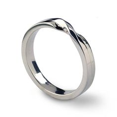 The cross of destiny of two lives in a knot of love is the inspiration for this beautiful, romantic wedding band, which is suitable for both men and