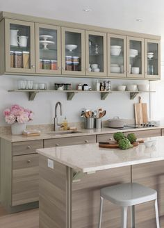 Small Kitchen Design Tip: Hide the refrigerator in the island to expand countertop and cabinet space. Click to learn more design tips and explore Martha Stewart's kitchen renovation. #kitchenrenovations