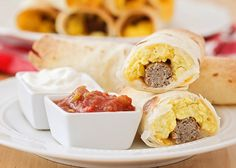 These delicious and savory baked breakfast taquitos are so delicious! They're loaded with eggs, cheese, and sausage, all wrapped in a crisp tortilla. Yum!