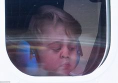 George  looks ready to go home as he presses up his nose to the window of the seaplane as the family depart Victoria