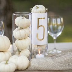 gorgeous gold table number and mini white pumpkin table setting